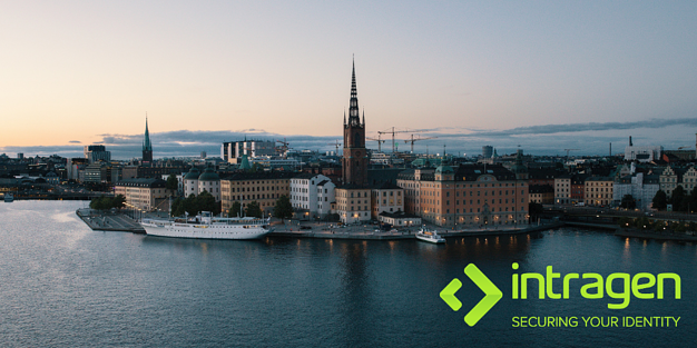 A photograph of Stockholm from the sea. A church  spire is centred with surrounding buildings and the sunsetting sky above and sea below. The green Intragen logo is in the bottom right corner.